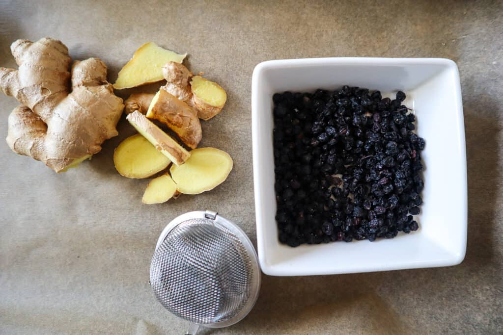 Fresh ginger and Dried Elderberries with tea infuser