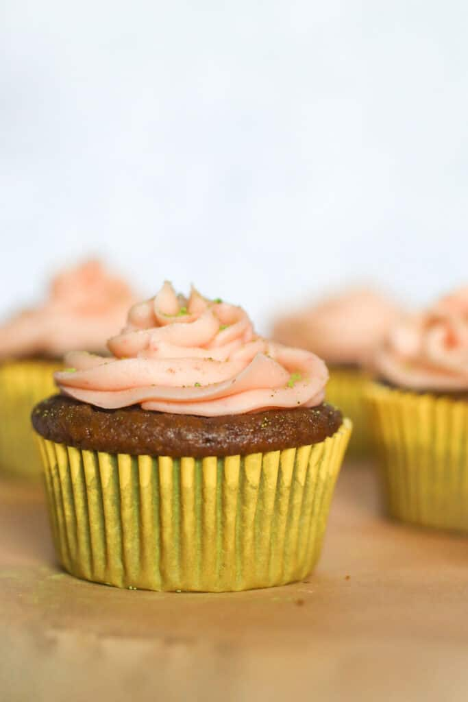Close up of gluten free matcha cupcakes with strawberry buttercream