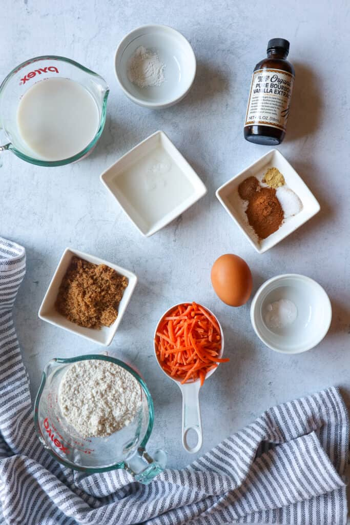 Ingredients needed to make carrot cake pancakes: almond milk, baking powder, vanilla extract, coconut oil, cinnamon, ground ginger, nutmeg, salt, brown sugar, egg, carrots, gluten-free all purpose flour