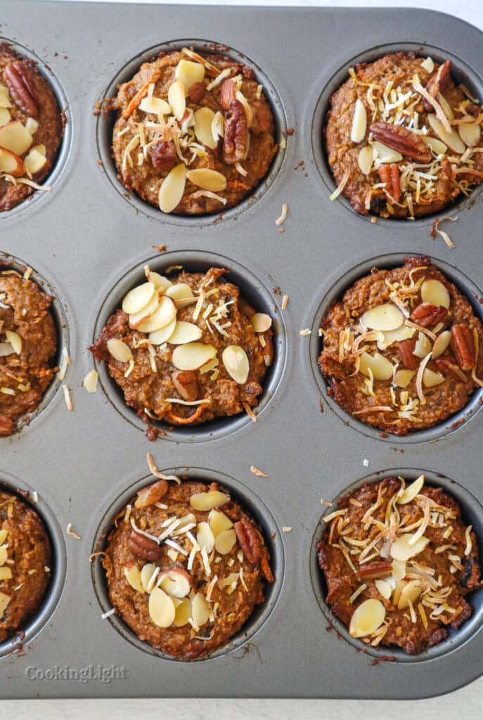 image of carrot cake muffins in muffin tin fresh out of the oven