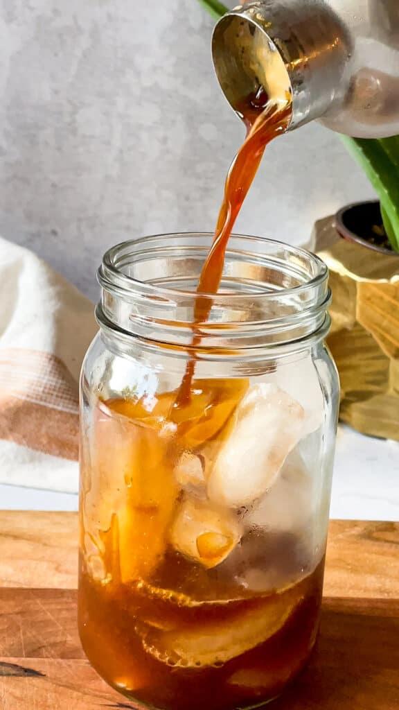 Adding Espresso to ice to make shaken espresso starbucks drink