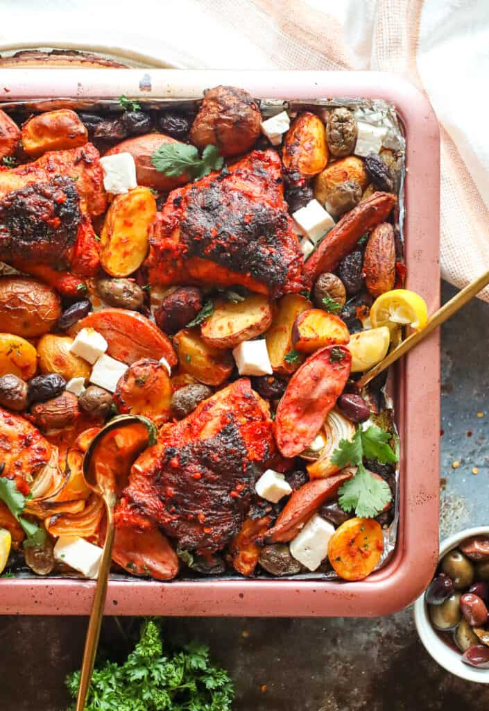 Sheet Pan Harissa Chicken with Potatoes, feta cheese, olives, and fresh herbs