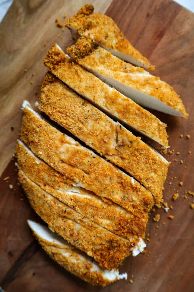 sliced gluten free breaded air fryer chicken breast. close up to show texture