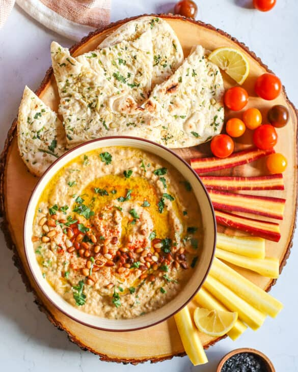 baba ganoush recipe served with pita carrots and tomatoes