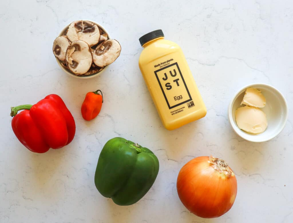 ingredients to Make Just Egg Scramble: Mushrooms, red pepper, green pepper, habanero, vegan butter, 1 container of JUST Egg