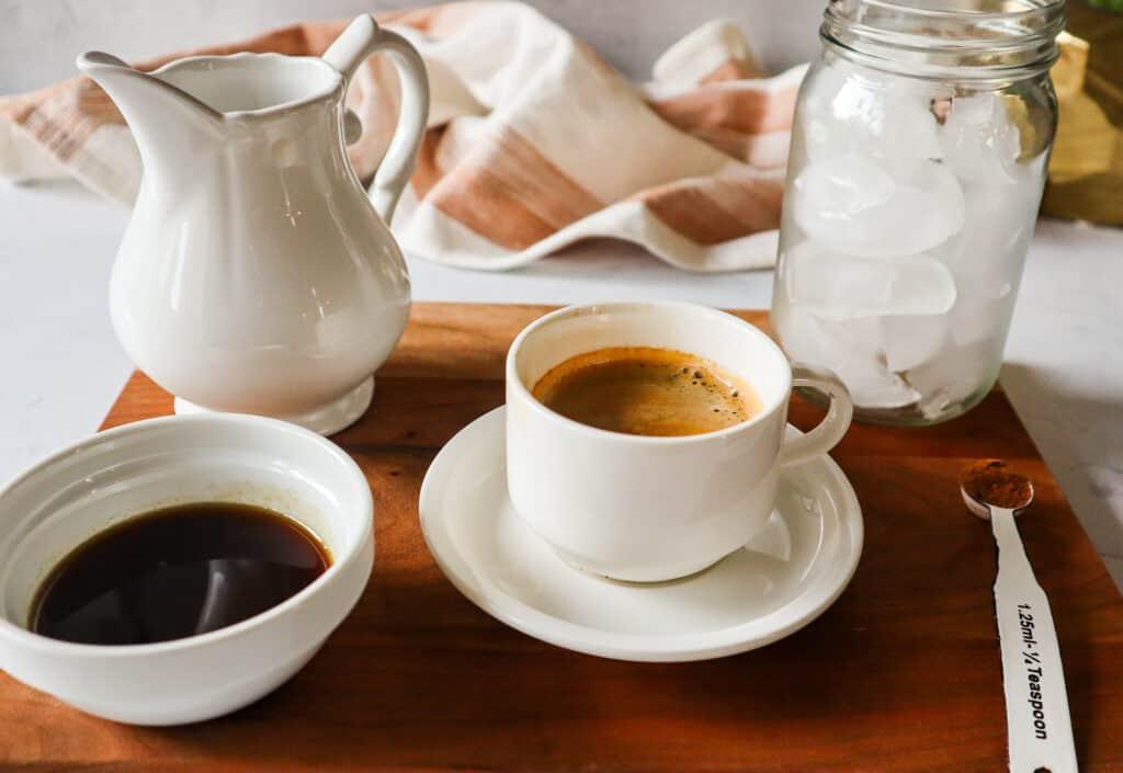 Ingredients needed to make starbucks copycat brown sugar oat milk shaken espresso: oat mik, brown simple syrup, cinnamon, ice, espresso, shaker.